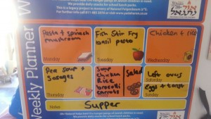 Menu planning on a magnetic board and stuck on the fridge, so everyone knows what's for dinner