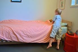 Kids can learn to pull a duvet straight from a young age