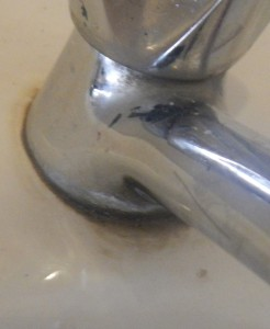 old soap residue around the bathroom tap/faucet