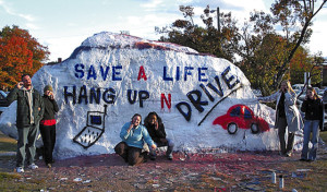 Safe cell phone use advocates, from left, Troy Creason, Annette Skoczylas (CQ), Kristin Kelly, Jocelyn Wilson, Dana Moody and Lisa Fuller display their message on the Rock on Oct. 28, 2008 at the University of Tennessee. Members of the group want get the message out about the dangers of talking while driving as part of a public health class they are taking.